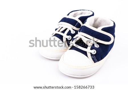 Baby shoe on isolated white background