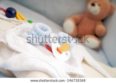 Baby Shoes and Pacifier with Teddy / baby stuff - stock photo
