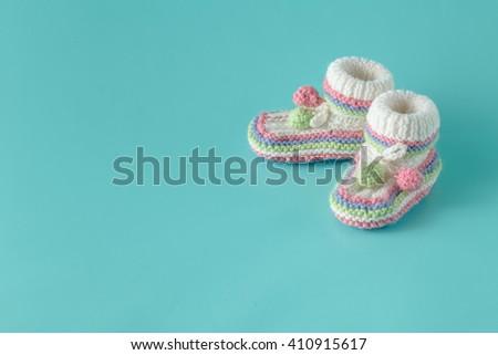 baby shoes on aquamarine background
