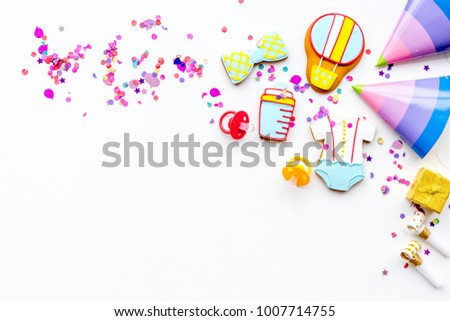Baby shower. Cookies in shape of accesssories for child and party hats on white background top view copy space #1007714755