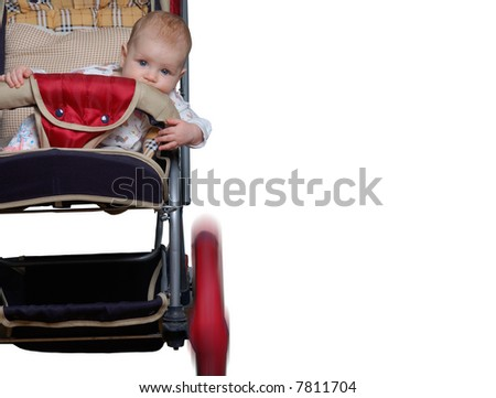 baby, sitting in a carriage, as if he has participate in a rally or pursuit - stock photo