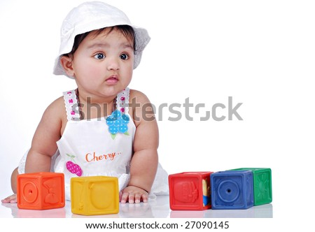 baby sitting with colorful blocks