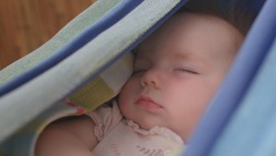 Baby sleep in the hammock. Toddler dreams are just snapshots, looking like a slideshow. The REM sleep stage is when neural connections go into overdrive, meaning that REM promotes development. Closeup