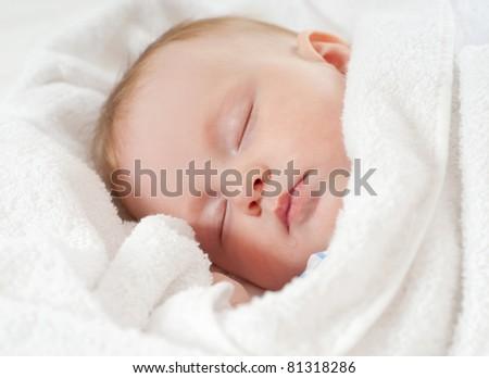 baby sleep under a white blanket