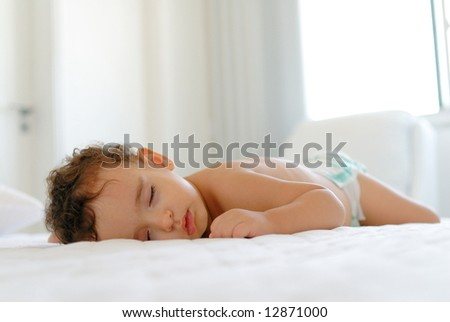 Baby Sleeping and having a sweet dreams . - stock photo