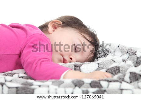 Baby sleeping on a blanket in a white isolated background
