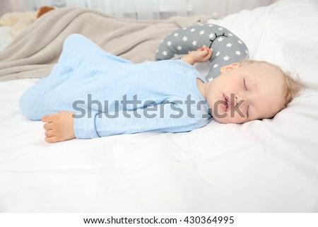 Baby sleeping on bed #430364995