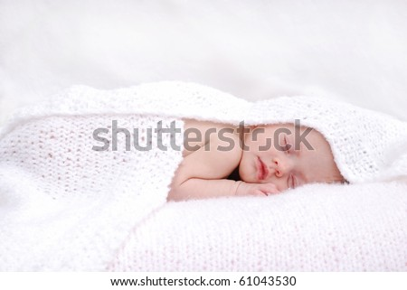 baby sleeping with blanket