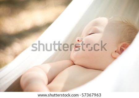 Baby sleeps quietly in hammock