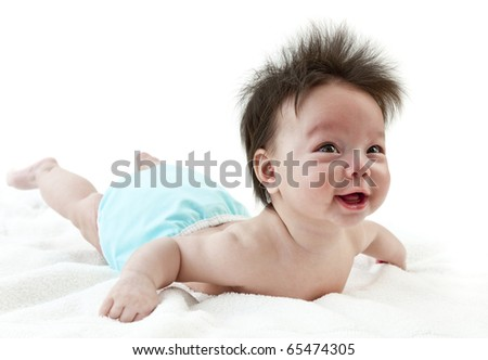 Baby smiling while practicing tummy time. Baby wearing cloth diaper