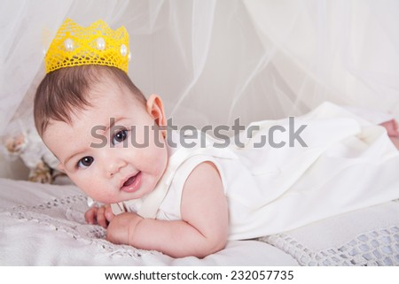 baby smiling with a crown