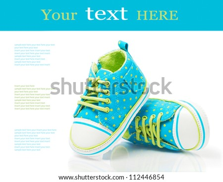 Baby sneakers on white with sample text