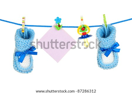 baby socks and booties isolated on white