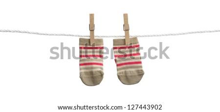 Baby socks hanging on clothesline