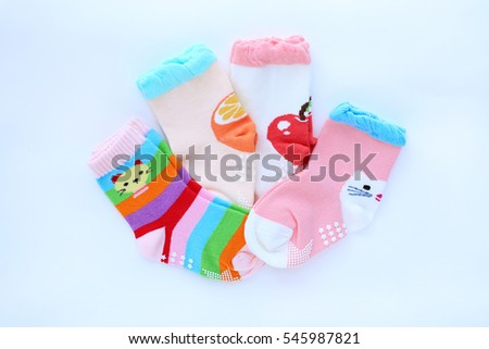 Baby socks on white background. Top view