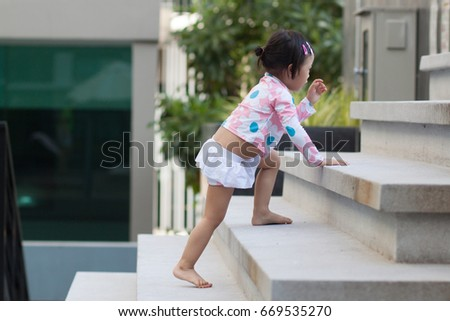 Baby Step Up The Stairs In Swimming Suit #669535270