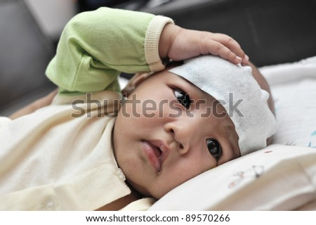 Baby suffering heat from fever