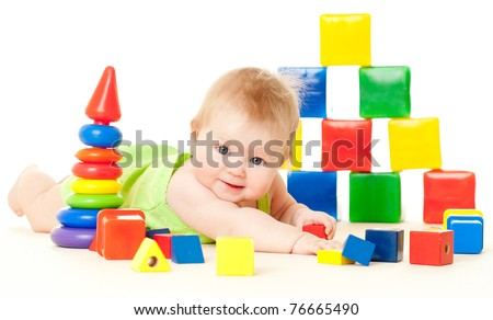 baby, surrounded by toys on a white background