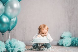 Baby sweet littleboy gril green blue cake smash bite into cake decoration clean background