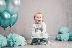Baby sweet littleboy gril green blue cake smash eating bif cake decoration clean background