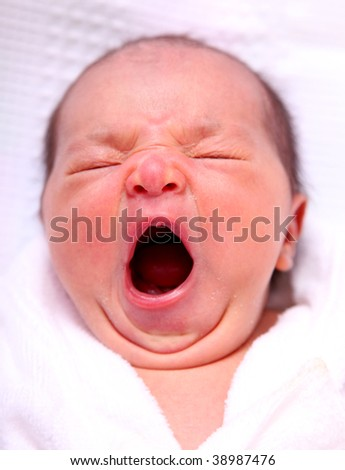 baby to yawn over white background. beauty image