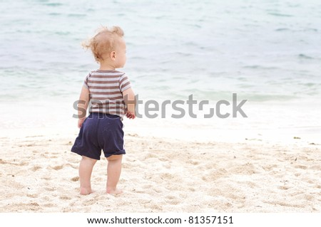 Baby, toddler boy on a tropical beach - stock photo