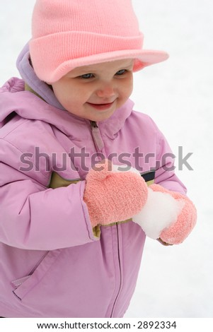 Baby (Toddler) Playing with a snow