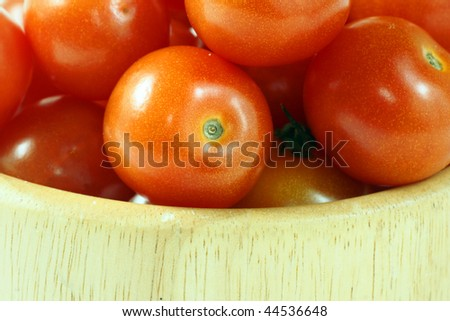 baby tomatoes in wooden bowl - stock photo