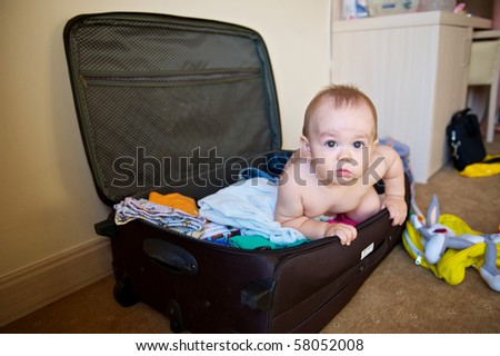 Baby travels in a suitcase