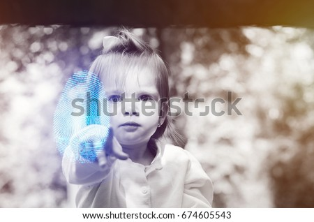baby two years pointing a fingerprint at the camera, digital and copy space #674605543