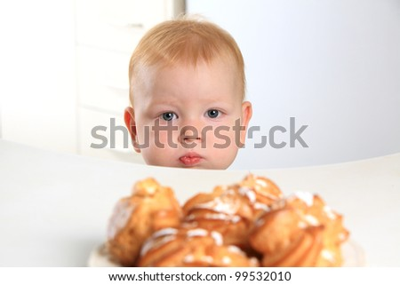 baby wants cake on the table