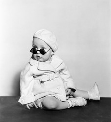Baby wearing beret and sunglasses