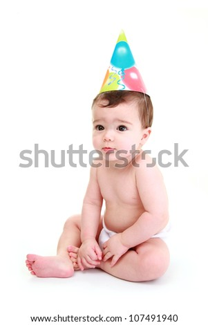 Baby wearing party hat