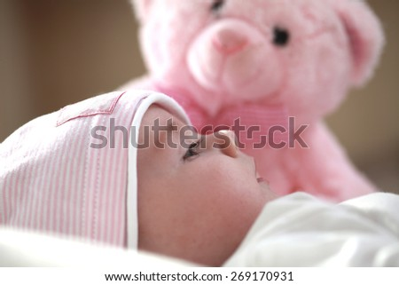 baby with a pink teddy bear