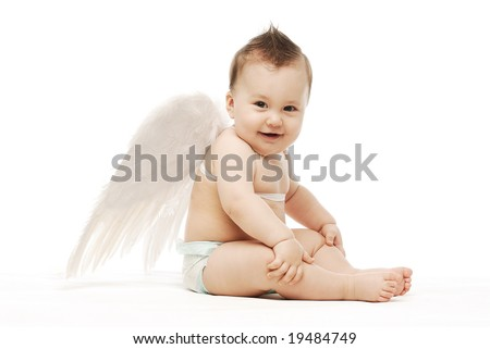 Baby with angel wings sitting sideways laughing  holding his knees