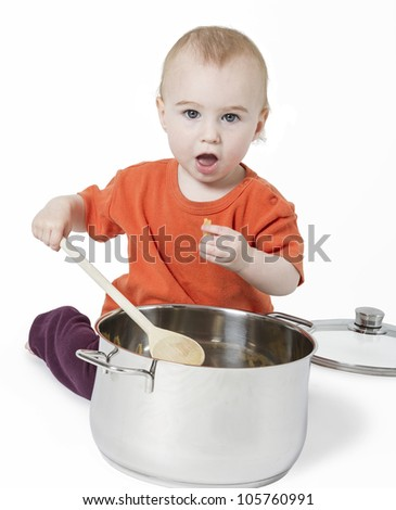 baby with big cooking pot isolated on white background