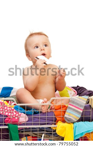 Baby with clothes and credit card on white