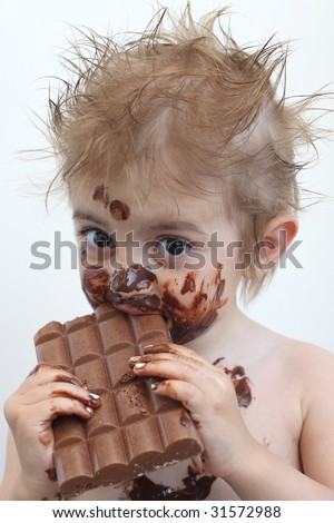 Baby with face covered in chocolate