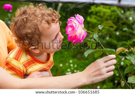baby with flower in hand