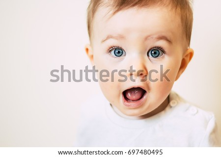 Baby with flu looking surprised
