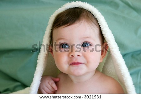 baby with fluffy blanket on head