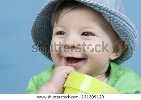 baby with hat outdoors