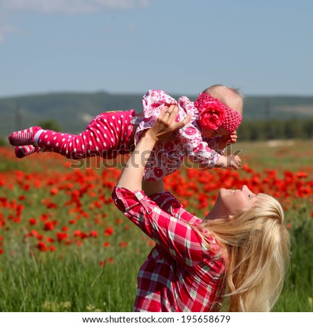 baby with his mother enjoying a field day outdoors.Mothers day holiday concept