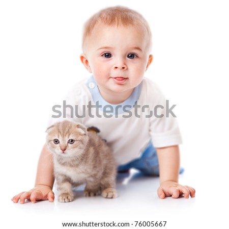 Baby with kitten. Isolated on white background
