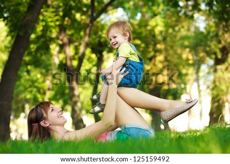 baby with mom in a beautiful summer park
