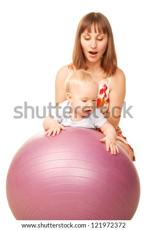 Baby with mother playing sports on fitness ball.  Isolated on white background.