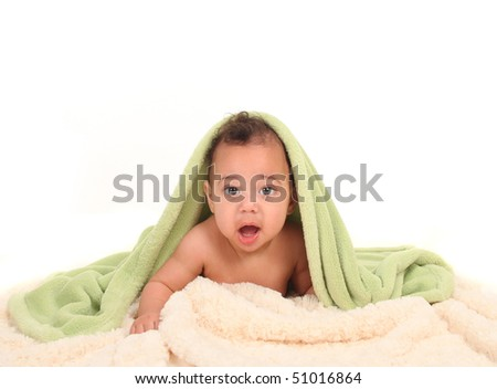 Baby With Mouth Open Lying on Tummy With Blankets