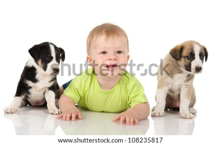 baby  with puppy dog. isolated on white background