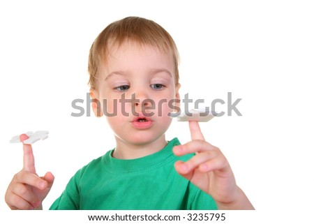 baby with puzzle on finger