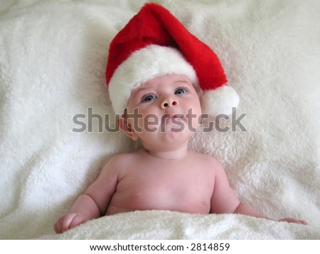 baby with santa hat on